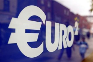 A Euro sign is seen in the window of a discount store on Moore Street in Dublin