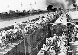 Masse di esuli sui treni di qua e di la' dei confini tra India e Pakistan nel 1947