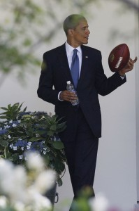 president-barack-obama-plays-with-a-football-930x1399