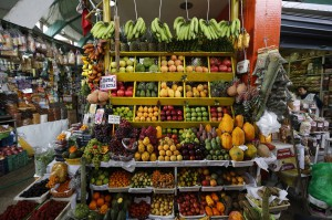 Fruits and vegetables are displayed for sale at a stand at a market in Lima's Surquillo district