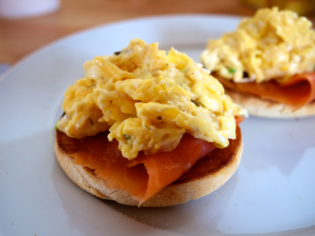 Eggs scrambled with cream cheese and spring onions, and smoked salmon on a toasted English muffin.