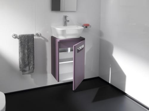 Sotto il lavavo xsmall, si apre il mobile contenitore. Un dettaglio salva-spazio della linea The gap di Roca
