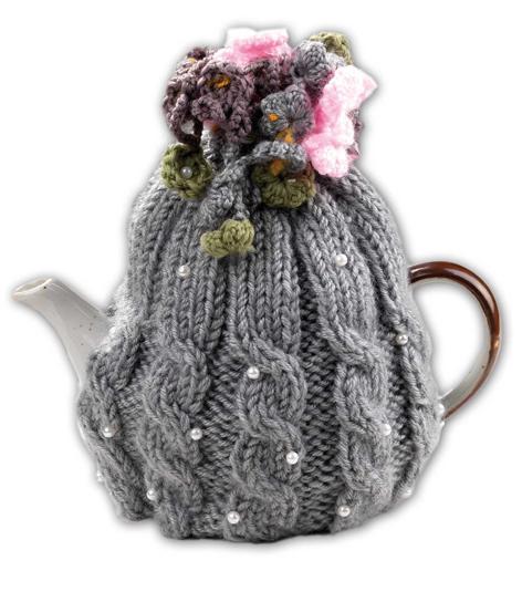 Copriteiera in lana lavorata ai ferri con perline e fiori lavorati all'uncinetto. Di Rosso Regale