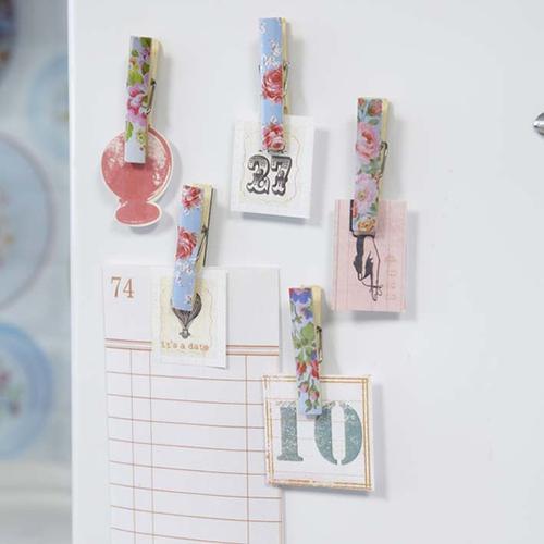 Mollette decorate con motivo floreale da applicare a muro