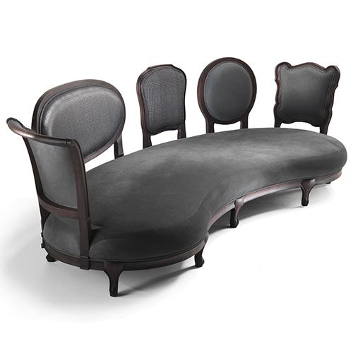 A ognuno il suo preferito: il divano Back to Back di Fratelli Boffi è caratterizzato da più  appoggi, ispirati ai più classici schienali di sedie, che separano i posti a sedere