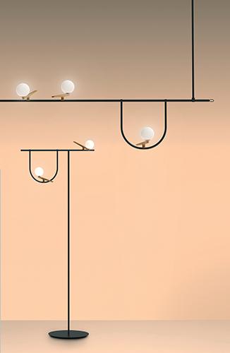 """<em>Yanzi</em> è la famiglia di lampade di <a href=""""http://www.artemide.it/"""">Artemide</a> che si ispira al concetto di leggerezza: su strutture lineari, come rami, poggiano rondini dal cuore luminoso"""