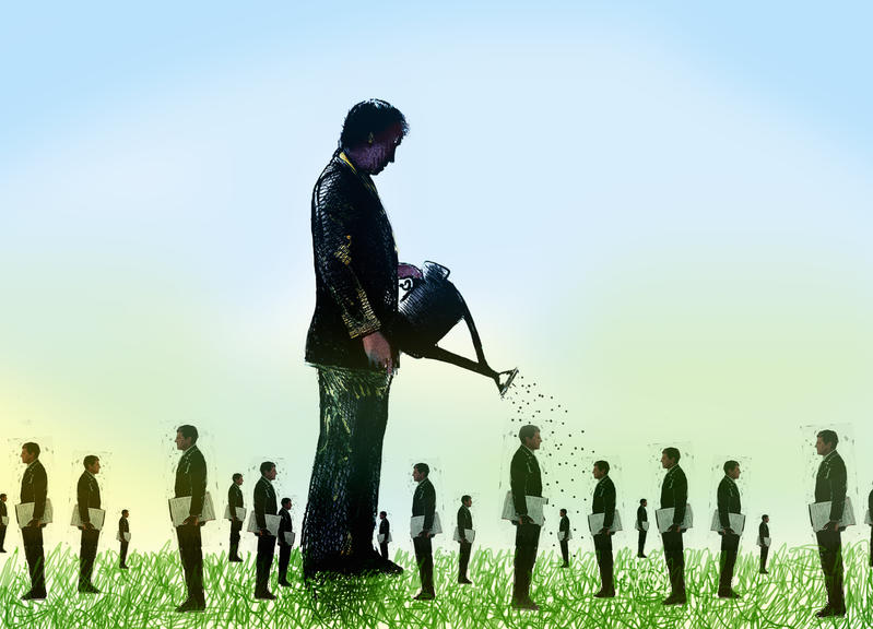 Large businessman nurturing lots of small businessmen