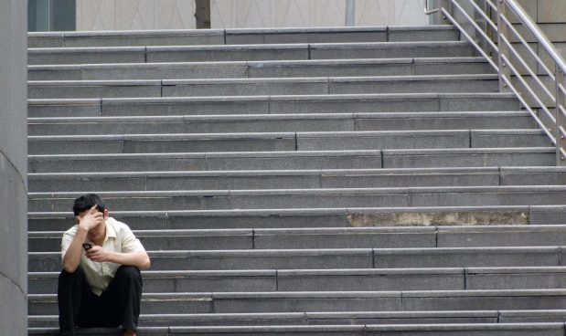 man stressed staircase
