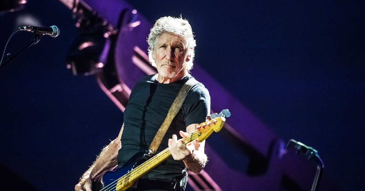 Roger Waters playing guitar
