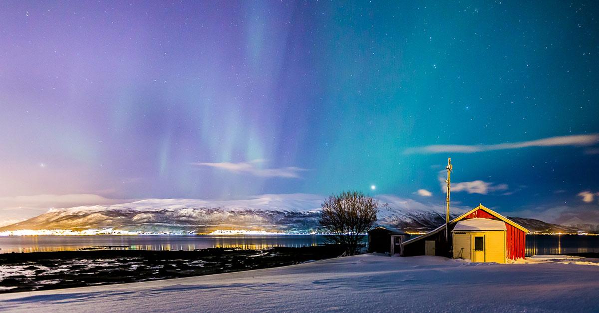 Norvegia, nel regno dell'aurora boreale: lo spettacolo oltre il circolo polare artico