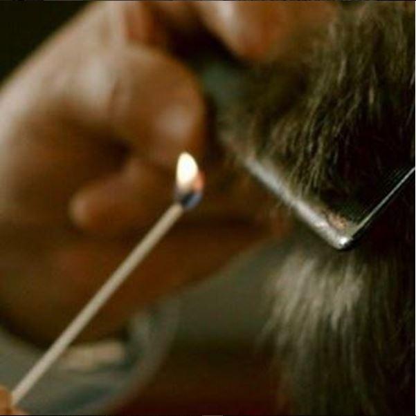 A Milano c'è un barbiere che taglia i capelli col fuoco ...