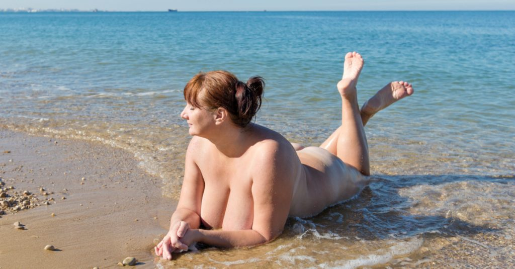 adults only nudist beach couple
