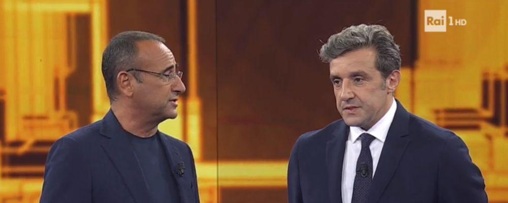 L'eredità, Flavio Insinna riceve le chiavi dello studio da Carlo Conti: 'Sono le più pesanti del mondo'