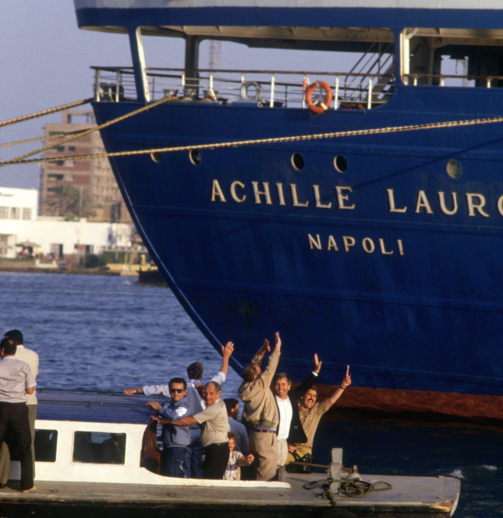 Released hostages of the Achille Lauro liner hijacking are being taken ashore after the four Palestinian hijackers surrendered. (Photo by Bernard Bisson/Sygma via Getty Images)