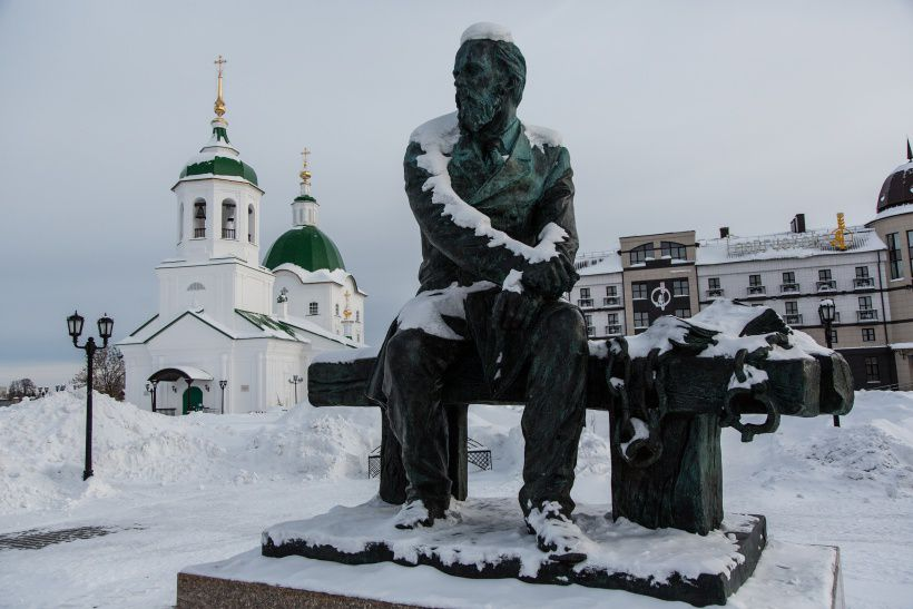 TOBOLSK, SIBERIA, RUSSIA - JANUARY 20: A monument to Fyodor Dostoevsky, a famous classic Russian writer, by a sculptor Mikhail Pereyaslavets in the city of Tobolsk, Russia. The monument was opened in 2010, and stands next to the Church of Peter and Paul, not far from the the Prison Castle, a strict regime prison in Tobolsk. The prison was built during 1838-1855. The architectural ensemble consisted of several cell blocks, a hospital for prisoners, an administrative building, and other premises. Through it's history, especially during the Soviets, the conditions in the prison were considered stricter than in colony. One of the most famous prisoners of the prison were Mikhail Mikhaylov, Vladimir Korolenko, Nikolay Chernyshevski. Fyodor Dostoyevski, a famous Russian writer, spent about 10 days in one of the prisons in Tobolsk while he was transferred to Omsk for penal servitude. The prison was closed in 1989. Now the Prison Castle is opened to tourists. It accomodates the city archive, a museum, a hostel, a libraty, etc. Tourists can stay in a hostel which used to be a block of sweat-boxes (punishments cells).(Photo by Alexander Aksakov/Getty Images)