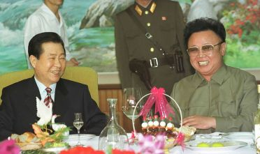 370952 07: South Korean President Kim Dae-jung, left, and North Korean leader Kim Jong Il share a laugh at a luncheon June 15, 2000 held in Pyongyang, North Korea. The South Korean president is scheduled to fly back to South Korea later after three days of meetings with Kim Jong Il, the first between leaders of the divided Korea''s since the country split more than 50 years ago. (Photo by Newsmakers)