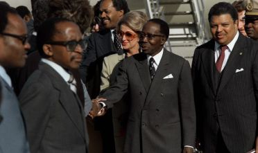President Leopold Senigor of Senegal, middle, and members of his party are welcomed upon their arrival in the United States for a visit.