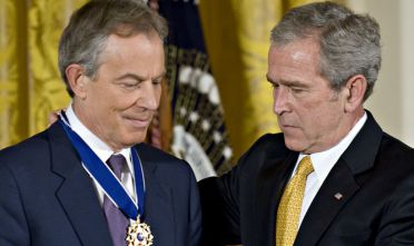 UNITED STATES - JANUARY 13:  U.S. President George W. Bush, right, presents a Presidential Medal of Freedom to Tony Blair, former prime minister of the United Kingdom, during a ceremony in the East Room of the White House in Washington, D.C., U.S., on Tuesday, Jan. 13, 2009. Bush also presented medals to John Howard, former prime minister of Australia, and Alvaro Uribe, president of Colombia.  (Photo by Mannie Garcia/Bloomberg via Getty Images)