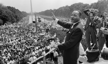 """The civil rights leader Martin Luther KIng (C) waves to supporters 28 August 1963 on the Mall in Washington DC (Washington Monument in background) during the """"March on Washington"""". King said the march was """"the greatest demonstration of freedom in the history of the United States."""" Martin Luther King was assassinated on 04 April 1968 in Memphis, Tennessee. James Earl Ray confessed to shooting King and was sentenced to 99 years in prison. King's killing sent shock waves through American society at the time, and is still regarded as a landmark event in recent US history. AFP PHOTO / AFP PHOTO / -        (Photo credit should read -/AFP/Getty Images)"""
