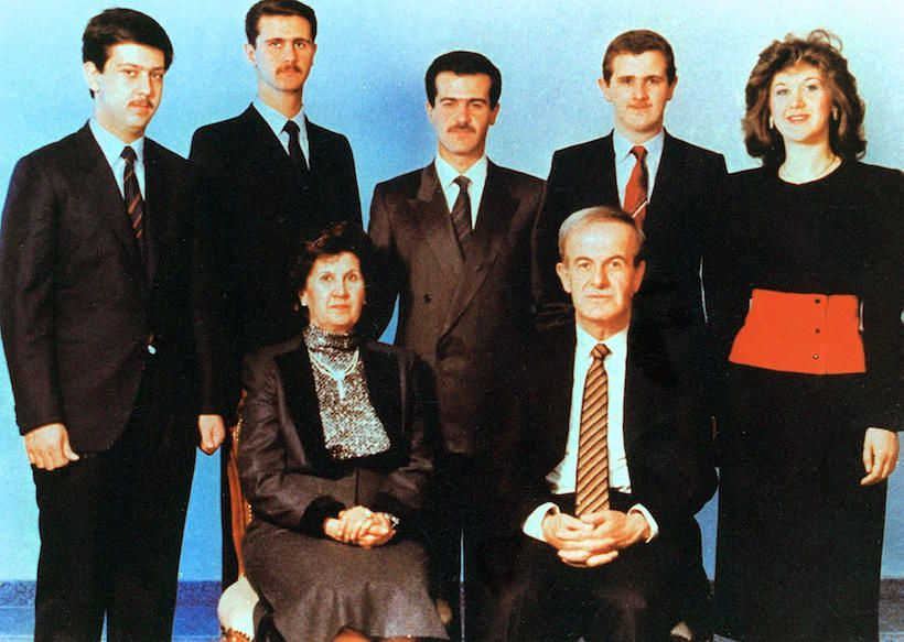Undated picture shows Syrian President Hafez al-Assad and his wife Anisseh posing for a family picture with his children (L to R) Maher, Bashar, Bassel, who died in a car accident in 1994, Majd and Bushra.  (Photo credit should read LOUAI BESHARA/AFP/Getty Images)