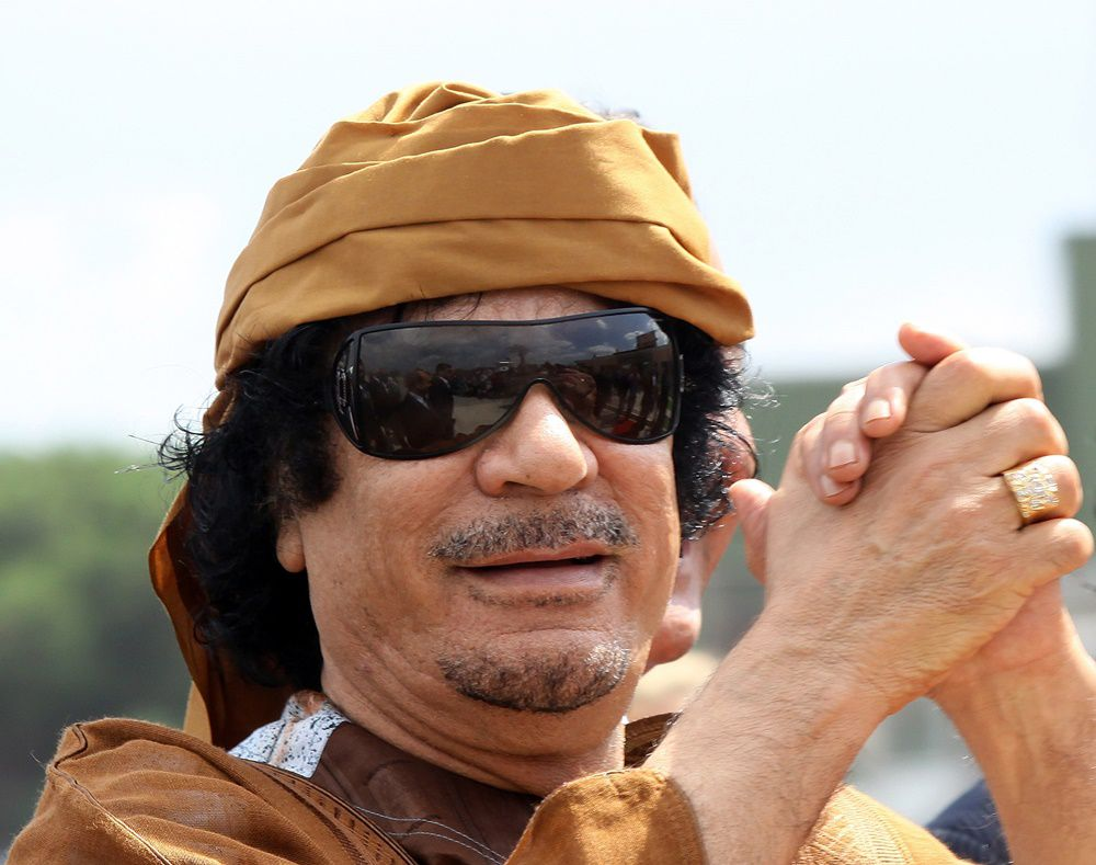 ROME - AUGUST 29:  Libyan leader Muammar Gaddafi arrives at Ciampino airport on August 29, 2010 in Rome, Italy.  Gadaffi is on an official two-day visit to Italy for talks with Prime Minister Silvio Berlusconi. The visit also marks the second anniversary of a friendship treaty between Italy and Lybia.  (Photo by Ernesto Ruscio/Getty Images)