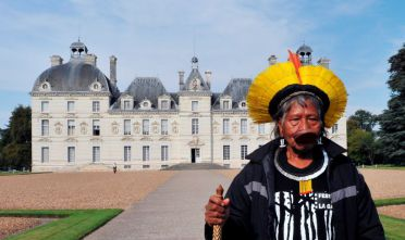 Raoni Metuktire, 81, the chief of the Amazonian Indian tribe Kayapo, poses infront of Chateau de Cheverny on September 24, 2011 at Cheverny, center France, during his visit in France in order to collect a petition in protest with the construction of the Belo Monte hydroelectric dam in the Amazonian Xingu River in Brazil. AFP PHOTO ALAIN JOCARD        (Photo credit should read ALAIN JOCARD/AFP/GettyImages)