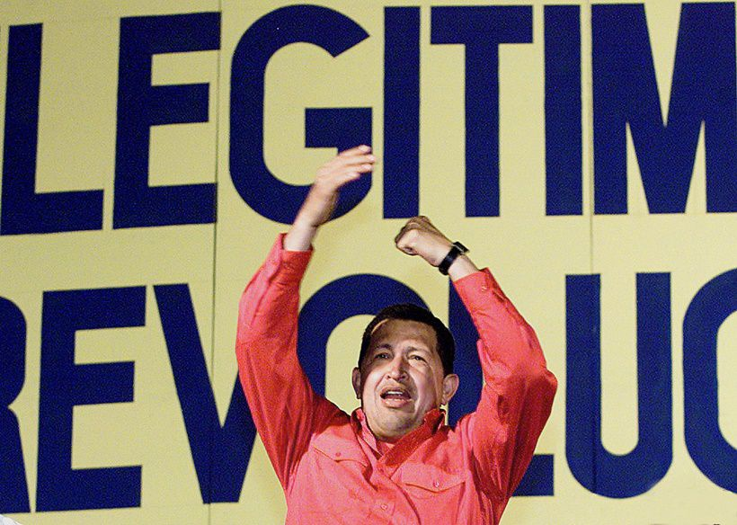 Venezuelan President Hugo Chavez gesticules during a political meeting in Caracas 29 July 2003, to celebrate his third reelection anniversary.                         (Photo credit should read ANDREW ALVAREZ/AFP/Getty Images)