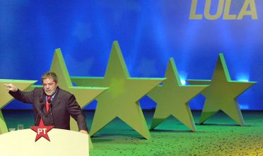 Luis In?cio Lula da Silva, Brazilian presidential candidate of the Workers Party, addresses the National Convention 29 June 2002 in Sao Paulo, Brazil. Polls show Lula -- making his fourth try for the presidency -- leading Jose Serra, the candidate of President Fernando Henrique Cardoso's Brazilian Social Democratic Party, but without the majority needed to avoid a runoff vote. Brazil's presidential elections are to be held in October 2002.     AFP PHOTO/MAURICIO LIMA  (Photo credit should read MAURICIO LIMA/AFP/Getty Images)