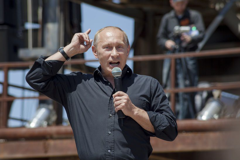 Prime Minister Vladimir Putin addresses the crowd at a Night Wolves' bike show in Crimea