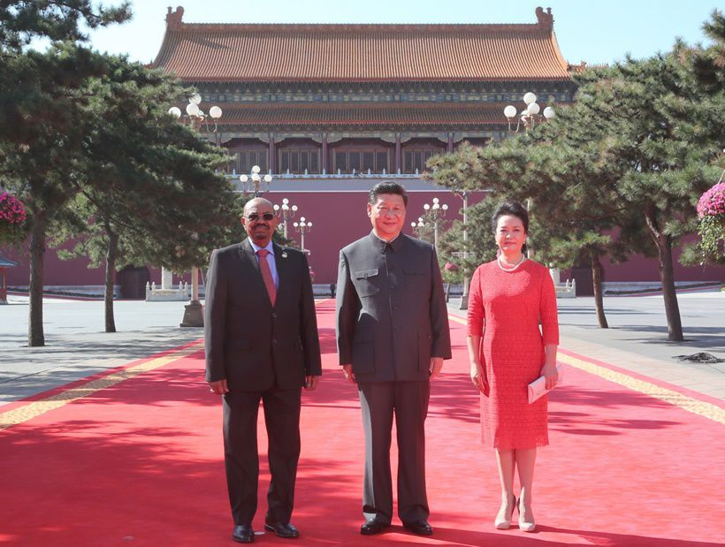 03 Sep 2015, Beijing, China --- (150903) -- BEIJING, Sept. 3, 2015 (Xinhua) -- Chinese President Xi Jinping (C) and his wife Peng Liyuan (R) pose for a group photo with President Omar Hassan Ahmad al-Bashir of Sudan, ahead of the commemoration activities to mark the 70th anniversary of the Chinese People's War of Resistance Against Japanese Aggression and the World Anti-Fascist War, in Beijing, capital of China, Sept. 3, 2015. (Xinhua/Ding Lin) (mcg) --- Image by © Ding Lin/Xinhua Press/Corbis