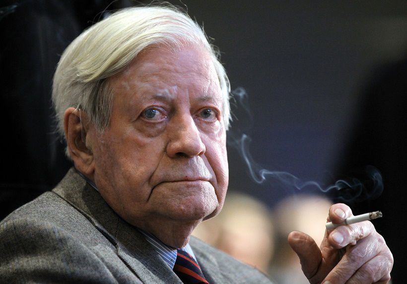29 Sep 2011, Berlin, Germany --- FILE - A file picture dated 16 November 2010 shows former German chancellor Helmut Schmidt (SPD) smoking a cigarette during the 17th annual meeting of the deutsche Nationalstiftung (German National Foundation) at the Axel Springer building in Berlin, Germany. PHOTO: WOLFGANG KUMM/DPA --- Image by © Wolfgang Kumm/dpa/Corbis