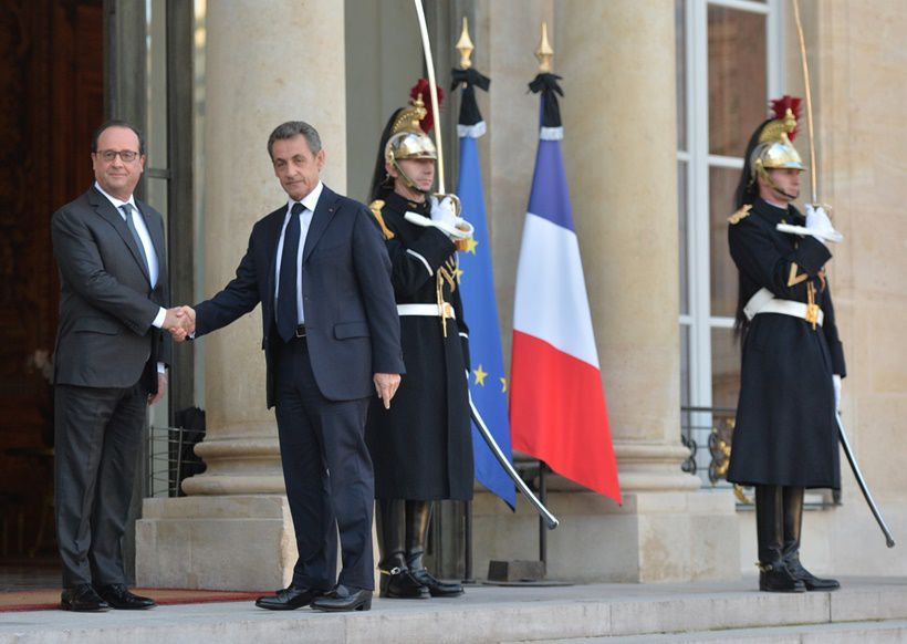 15 Nov 2015 --- French president Francois Hollande receives former president Nicolas Sarkozy at the Elysee Palace after the terrorist attacks in Paris, France on November 15, 2015. Photo by Christian Liewig --- Image by © Christian Liewig/Liewig Media Sports/Corbis