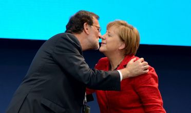 22 Oct 2015, Madrid, Spain --- Madrid, Spain. 22nd October 2015 -- Mr. Mariano Rajoy, the Spanish Prime Minister, welcomes German Chancellor Angela Merkel as she attends the Summit of Heads of State at the European People's Party in Madrid. -- German Chancellor Angela Merkel attended the Summit of Heads of State at the European People's Party in Madrid. --- Image by © Czuko Williams/Demotix/Corbis