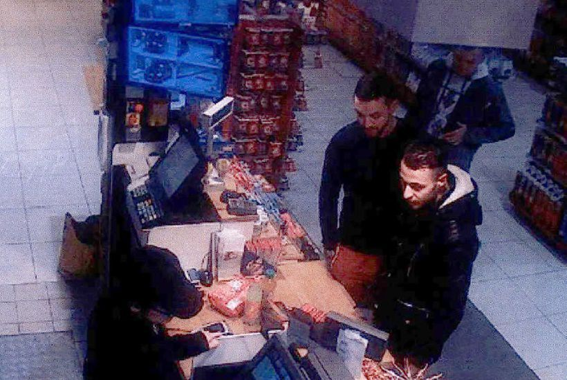 TOPSHOT - This video image taken from a CCTV camera at a petrol station in Ressons, North of Paris, on November 11, 2015 shows Salah Abdeslam (R), a suspect in the Paris attack of November 13, and Mohamed Abrini (C) buying goods. Investigators are still seeking Salah Abdeslam, a 26-year-old Frenchman living in Belgium, who is thought to have hired the cars used by the attackers and arranged hotel apartments for the nights before the rampage and Mohamed Abrini, a 30-year-old Moroccan Belgian, suspected of having participated in scouting out the attack sites with Abdeslam. / AFP / OFF / - (Photo credit should read -/AFP/Getty Images)