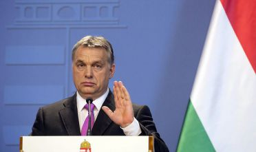 "Viktor Orban, Hungary's prime minister, gestures during a joint news conference with David Cameron, U.K. prime minister, in Budapest, Hungary, on Thursday, Jan. 7, 2016. On the euro, Cameron said that while Britain wants the shared currency to be a success, he wants to ensure ""that we're not called upon to support the euro zone financially."". Photographer: Balazs Mohai/Bloomberg via Getty Images"