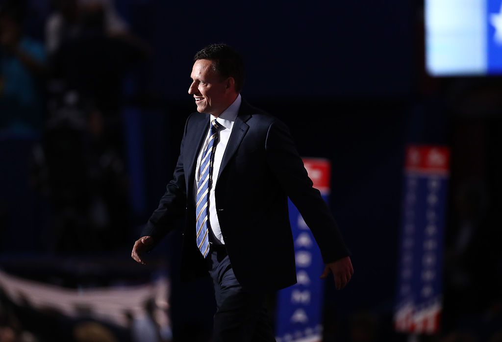 Peter Thiel, co-founder of PayPal Inc., arriving on stage during the Republican National Convention (RNC) in Cleveland, Ohio, U.S., on Thursday, July 21, 2016. This evening marks the last night of a four-day Republican National Convention that has been defined by disorderly floor activity, divisions within the party, a plagiarized speech delivered by the nominee's wife and scattered protests in the streets of Cleveland. Photographer: Andrew Harrer/Bloomberg via Getty Images