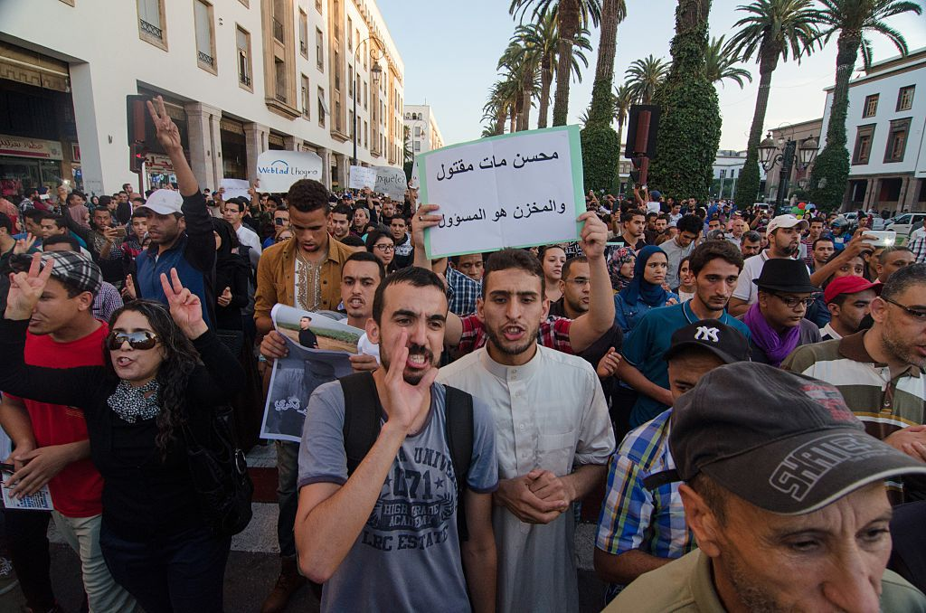 RABAT, MOROCCO - OCTOBER 30: Moroccan people stage a protest after a fisherman Mohcine Fikri, crushed to death in a garbage truck, in front of Internal Ministry in Rabat, Morocco on October 30, 2016. (Photo by Jalal Morchidi/Anadolu Agency/Getty Images)