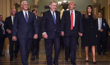 WASHINGTON, DC - NOVEMBER 10: President Elect Donald Trump, center right, walks through the halls of the U.S. Capitol for a meeting with Senate Majority Leader Mitch McConnell, center left, (R-KY) on November, 10, 2016 in Washington, DC.  Accompanying him are his wife, Melania, right, and Vice President Elect Mike Pence, left. (Photo by Bill O'Leary/The Washington Post via Getty Images)