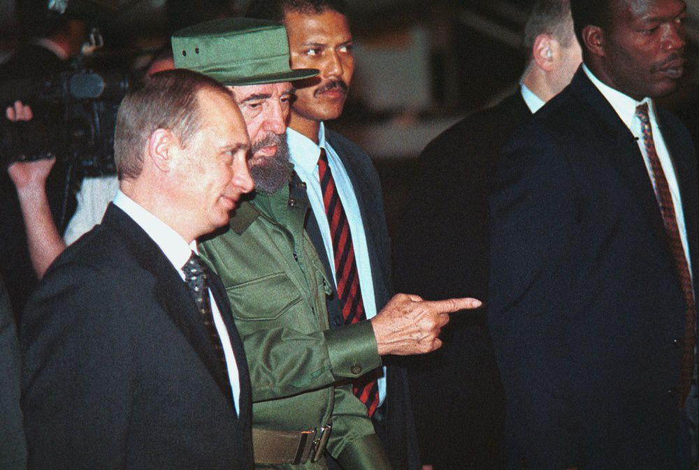383288 05: Cuban president Fidel Castro, center, talks with Russian President Vladimir Putin during a welcoming ceremony at the Jose Marti International Airport December 13, 2000 in Havana, Cuba. Putin''s visit is the first by a Russian head of state since the disintegration of the Soviet Union in 1991. (Photo by Jorge Rey/Newsmakers)