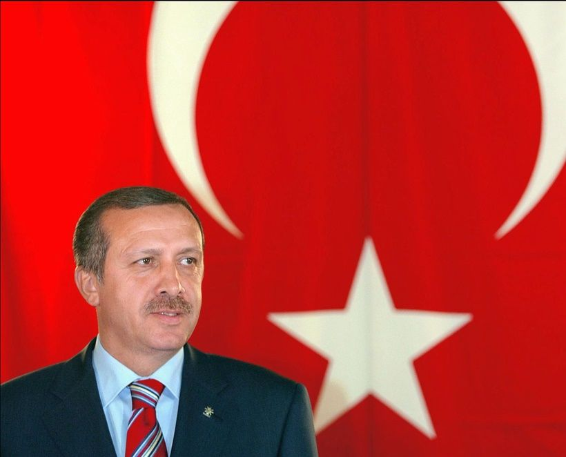 ROME, ITALY:  Recep Tayyip Erdogan, the leader of the Islamist-based party set to form a new government in Turkey, gives 13 November 2002 a press conference during his one-day visit in Rome. Erdogan meets Italian Prime Minister Silvio Berlusconi to press EU to start accession talks.  AFP PHOTO GABRIEL BOUYS (Photo credit should read GABRIEL BOUYS/AFP/Getty Images)