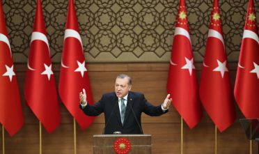 Turkish President Tayyip Erdogan gestures during his speech with mukhtars or local village and town leaders at the Presidential Palace in Ankara, on May 4, 2016.   / AFP / ADEM ALTAN        (Photo credit should read ADEM ALTAN/AFP/Getty Images)