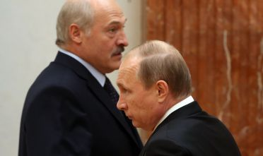 MINSK, BEALRUS - JUNE 8:  (RUSSIA OUT) Russian President Vladimir Putin (L) and Belarussian President Alexander Lukashenko (R) arrive to the meeting at the Presidential Palace on June 8, 2016 in Minsk, Belarus. Vladimir Putin is having a one-day visit to Minsk to attend the 3rd Regional Forum of Russia and Belarus (Photo by Mikhail Svetlov/Getty Images)