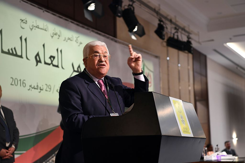 RAMALLAH, WEST BANK - NOVEMBER 29: Palestinian President Mahmoud Abbas delivers a speech during the 7th General Assembly meeting of Fatah Movement at Palestinian Prime Ministry office Mukataa in Ramallah, West Bank on November 29, 2016.   (Photo by Palestinian Presidency / Handout/Anadolu Agency/Getty Images)