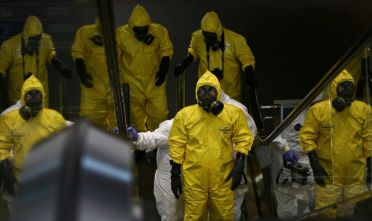 A Hazmat (hazardous materials) team conducts checks inside Kuala Lumpur Internatinal Airport 2 (KLIA2) airport terminal at Sepang, Malaysia, 26 February 2017. Malaysian police order a sweep of Kuala Lumpur airport for toxic chemicals and other hazardous substances following the killing of Kim Jong Nam (Photo by Mat Zain/NurPhoto via Getty Images)