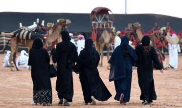Saudi women attend the annual King Abdulazziz Camel Festival in Rumah, some 150 kilometres east of Riyadh, on March 29, 2017.  The 28-day King Abdulaziz Camel Festival features a camel beauty contest, known as Miss Camel with prizes amounting to $30 million. / AFP PHOTO / FAYEZ NURELDINE        (Photo credit should read FAYEZ NURELDINE/AFP/Getty Images)