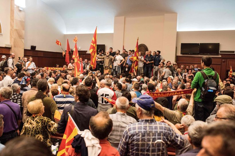 Protesters demonstrate inside Macedonia's parliament to protest against against what they said was an unfair vote to elect a parliamentary speaker, following months of political deadlock in the Balkan country in Skopje on April 27, 2017.  / AFP PHOTO / Robert ATANASOVSKI        (Photo credit should read ROBERT ATANASOVSKI/AFP/Getty Images)