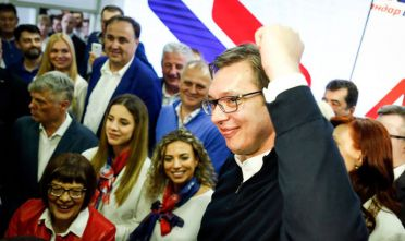 BELGRADE, SERBIA - APRIL 02: Serbian President-elect Aleksandar Vucic (R) celebrates after declaring a victory on April 2, 2017 in Belgrade, Serbia. According to the research Vucic won about 55 percent of the vote, above the 50 percent threshold required to win in the first round. (Photo by Srdjan Stevanovic/Getty Images)