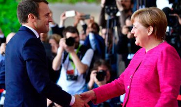 "French President Emmanuel Macron (L) is greeted by German Chancellor Angela Merkel (R) prior to talks at the Chancellery in Berlin on May 15, 2017. France's new President Emmanuel Macron secured backing from key ally Chancellor Angela Merkel for his bid to shake up Europe, despite scepticism in Berlin over his proposed reforms. Travelling to the German capital to meet the veteran leader in his first official trip abroad, Macron used the opportunity to call for a ""historic reconstruction"" of Europe.  / AFP PHOTO / John MACDOUGALL        (Photo credit should read JOHN MACDOUGALL/AFP/Getty Images)"