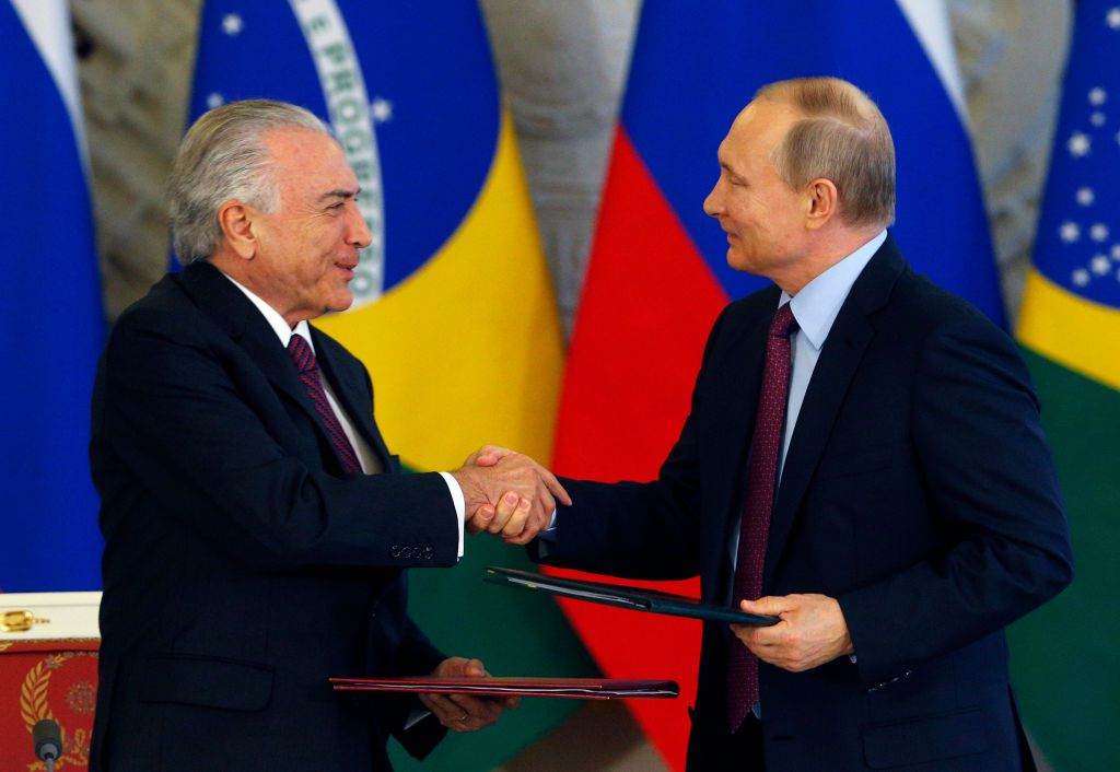 Russian President Vladimir Putin (R) shakes hands with his Brazil's counterpart Michel Temer during a signing ceremony following their meeting at the Kremlin in Moscow on June 21, 2017. / AFP PHOTO / POOL / Sergei Chirikov        (Photo credit should read SERGEI CHIRIKOV/AFP/Getty Images)