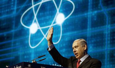 "Israeli Prime Minister Benjamin Netanyahu addresses the 4th Annual International Cybersecurity conference in Tel Aviv on September 14, 2014. Scores of veterans of elite Israeli intelligence unit 8200 rallied to its defence after 43 comrades said they would no longer take part in its ""injustices"" against millions of Palestinians in an open letter, which was sent to Israel's political and military leadership last week. Prime Minister Netanyahu said any form of refusing military service was ""condemnable"", calling the refuseniks' move ""political"" and based on ""unfounded accusations"". AFP PHOTO/ MENAHEM KAHANA        (Photo credit should read MENAHEM KAHANA/AFP/Getty Images)"